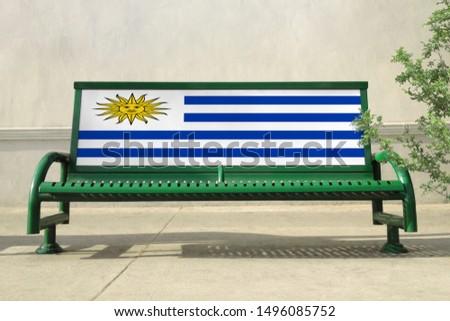 Flag of Uruguay on bench. Uruguay Flag on bench advertisement #1496085752