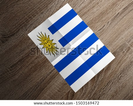 Flag of Uruguay on paper. Uruguay Flag on wooden table. #1503169472