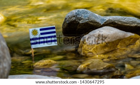 flag of Uruguay on the riverbank #1430647295