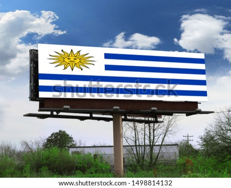 Flag of Uruguay on wooden board. Paper Flag of Uruguay on wooden table. #1498814132