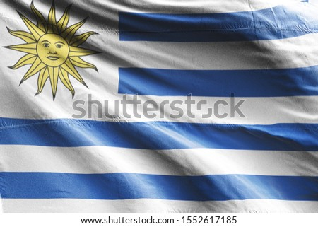 Flag of Uruguay waving. National Uruguay Flag for Independence day. #1552617185