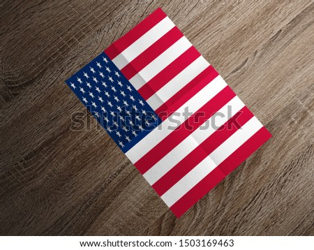Flag of USA on paper. USA Flag on wooden table.