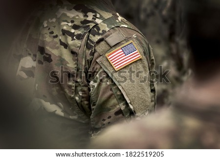 Photo of  Flag of USA on soldiers arm. Veterans Day. The United States Armed Forces. Military forces of the United States of America. Remembrance Day. Memorial day.