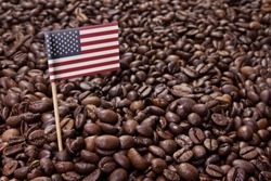 Flag of USA sticking in roasted coffee beans.(series)