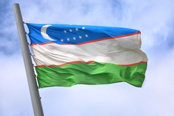 Flag of Uzbekistan against the sky
