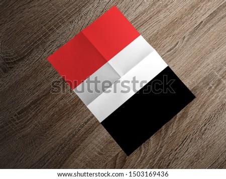 Flag of Yemen on paper. Yemen Flag on wooden table. #1503169436