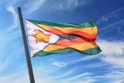 Flag of Zimbabwe against the background of the blue sky