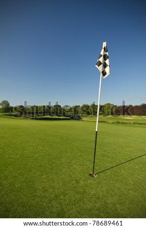 Flag on idyllic golf course