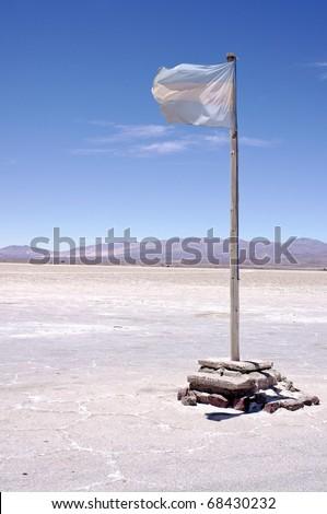 Flag on Salinas Grandes Salt Lake in North Western Argentina.