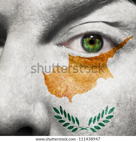 Flag painted on face with green eye to show Cyprus support