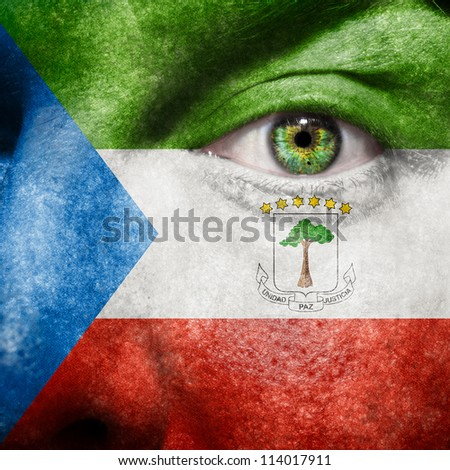 Flag painted on face with green eye to show Equatorial Guinea support