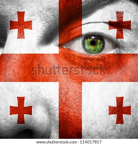 Flag painted on face with green eye to show Georgia support