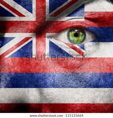 Flag painted on face with green eye to show Hawaii support