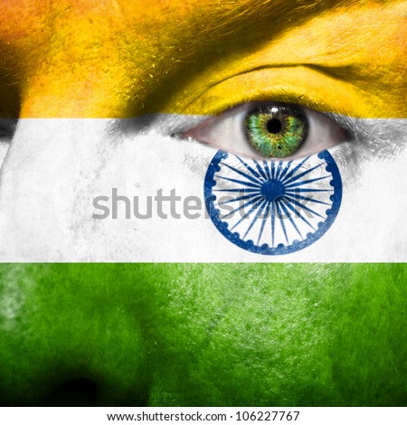 Flag painted on face with green eye to show india support