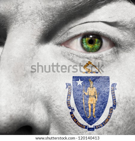 Flag painted on face with green eye to show Massachusetts support
