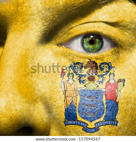 Flag painted on face with green eye to show New Jersey support