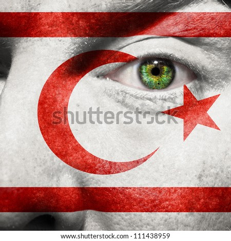 Flag painted on face with green eye to show Northern-Cyprus support