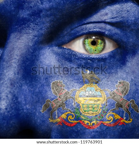 Flag painted on face with green eye to show Pennsylvania support