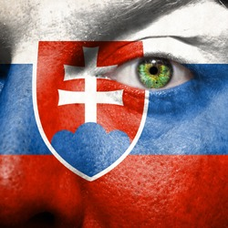 Flag painted on face with green eye to show Slovakia support