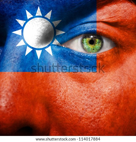 Flag painted on face with green eye to show Taiwan support