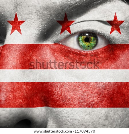 Flag painted on face with green eye to show Washington DC support