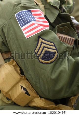 Flag patch on american soldier (Staff Sergeant) uniform.