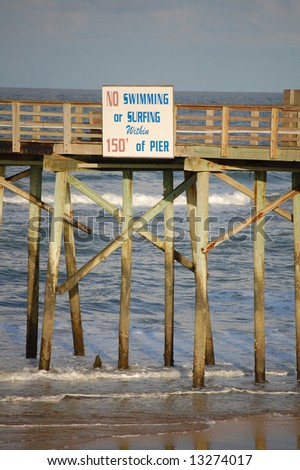 """Flagler Pier safety """"No swimming or surfing"""" sign"""