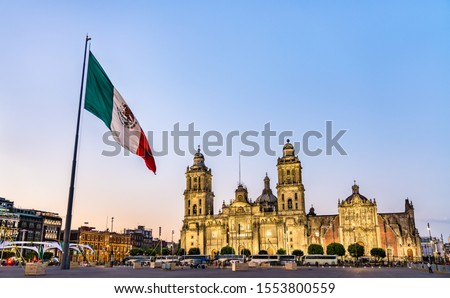 Flagpole and the Metropolitan Cathedral of the Assumption of Virgin Mary in Mexico City, the capital of Mexico