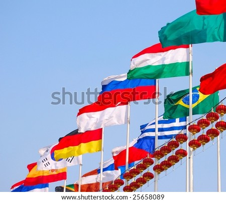 Flags against blue sky.