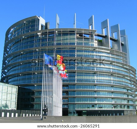 Flags aligned next to the European Parliament building, in Strasbourg, France
