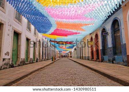 Flags hanging in the streets of sao luis do maranhao for the festival of sao joao, bumba meu boi Stockfoto ©