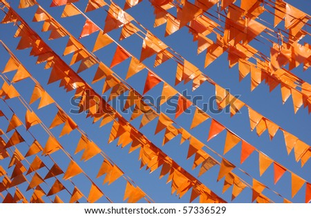 Flags in Dutch national color (orange) in the clear blue sky of Groningen, Holland.