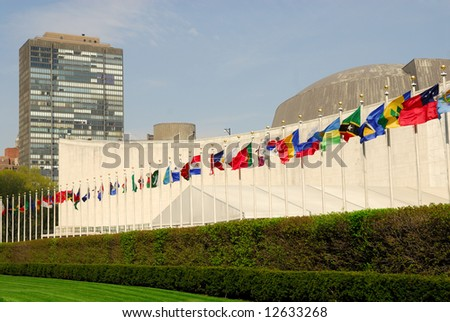 Flags in front of the UN Headquarters in New York - stock photo