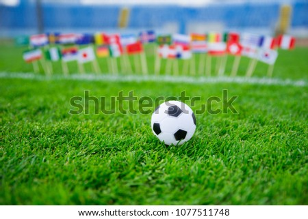 Flags of all football nations on green grass. Football ball, Fans, support photo, edit space.  #1077511748