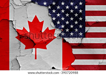 flags of Canada and USA painted on cracked wall #390720988