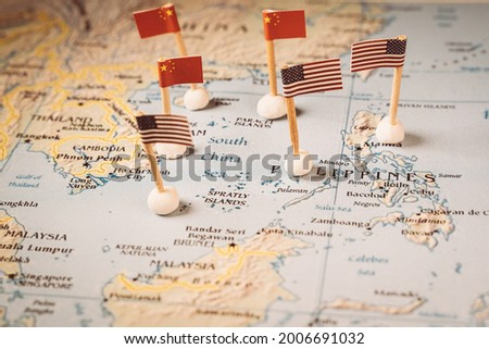 flags of china and the united states on a map of the south china sea. Concept of the south china sea diplomatic conflict