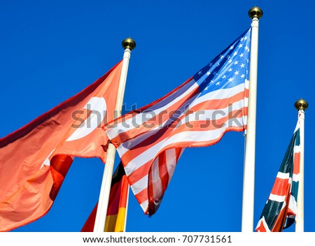 Flags of different countries on the background of blue sky #707731561