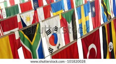 Flags of many countries hang vertically, representing a host of ethnic diversity from many cultures.