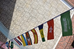 Flags of many countries, put together on a string in an international conference