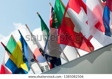 Flags of many nations on flagpoles  #1385082506