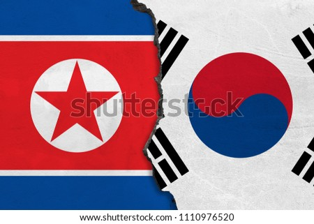 Flags of North Korea and South Korea painted on cracked wall #1110976520