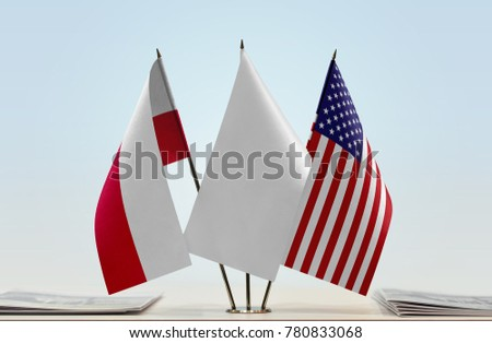 Flags of Poland and USA with a white flag in the middle #780833068