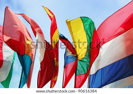 Flags of several Europe states against blue sky