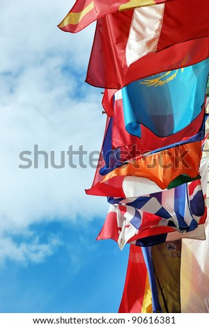 Flags of several Europe states against picturesque cloudy sky