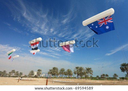 Flags of several nations competing in the Asian Cup football competition being held in Doha, Qatar, January 2011, fly from balloons in central Doha.