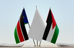 Flags of South Sudan and Jordan with a white flag in the middle