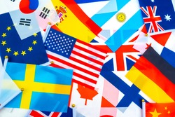 Flags of States and associations of States are on the table. The concept of mutually beneficial cooperation between States. The interaction between the two countries.