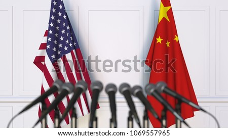 Flags of the USA and China at international meeting or conference. 3D rendering