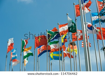 Flags of the world happily blowing in the wind.