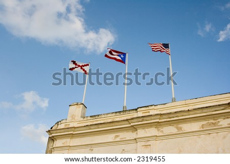 Flags of United States and Puerto Rico in an old fort